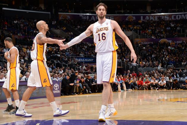 hi-res-460863611-robert-sacre-and-pau-gasol-of-the-los-angeles-lakers_crop_north